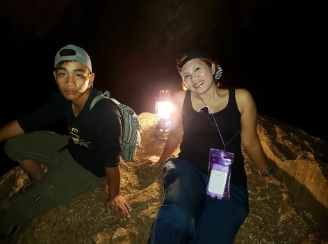 Before the fall, resting with my guide inside the cave